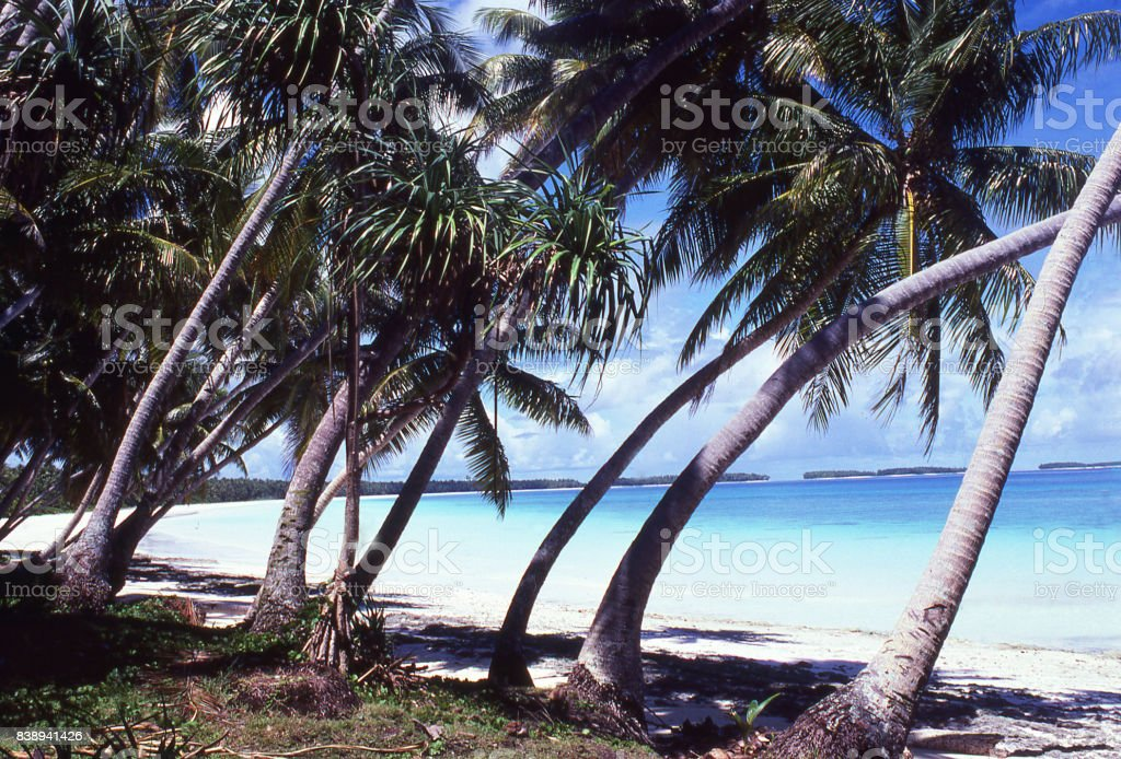 Inner lagoon and crystal clear water along sandy beach on atoll in the Marshall Islands Asia-Pacific stock photo
