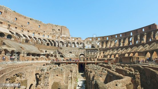 istock Inner part of Colosseum, people. Ancient landmark of Rome 1158797397