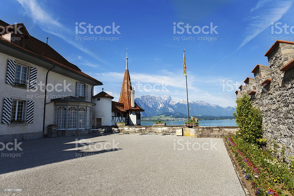 Inner yard of Oberhofen with flag royalty-free stock photo