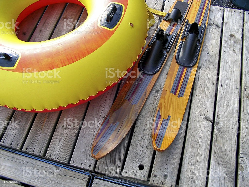 Innertube and Waterskis stock photo
