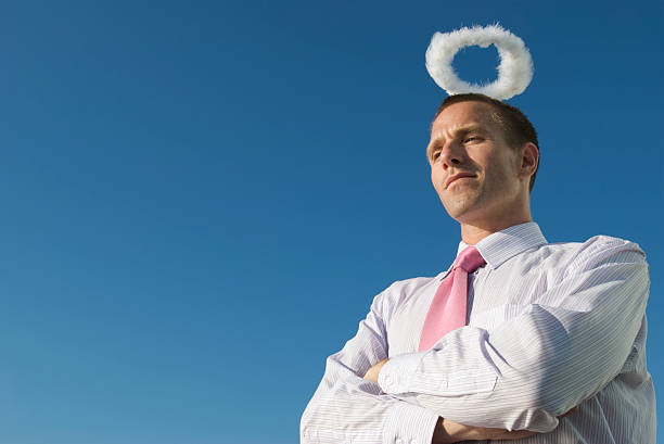 Innocent Angel Businessman with Fluffy Halo Blue Sky stock photo