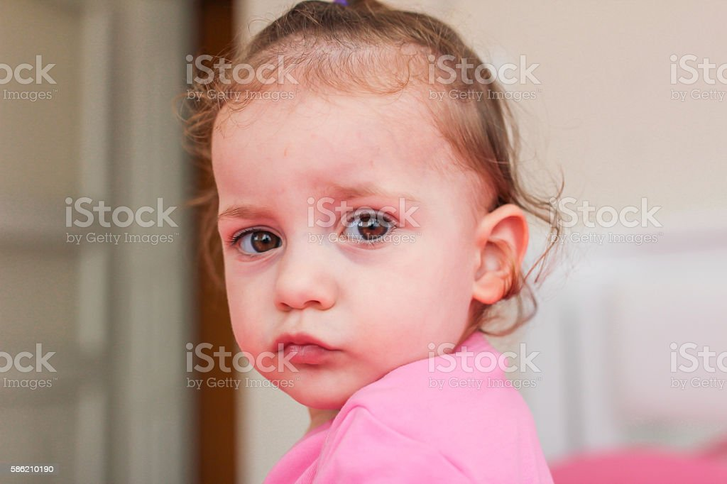 innocent expression stock photo