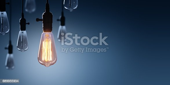 istock Innovation And Leadership Concept - Glowing Bulb lamp 689955934