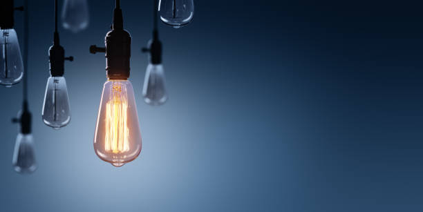 innovation and leadership concept - glowing bulb lamp - efficiency stock photos and pictures