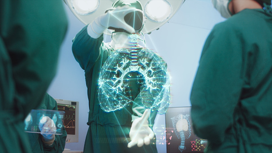 Innovation and Medical technology Concept, Surgeons Team using hi-tech modern virtual reality simulator interface with Hologram diagnose Respiratory System in the operating room
