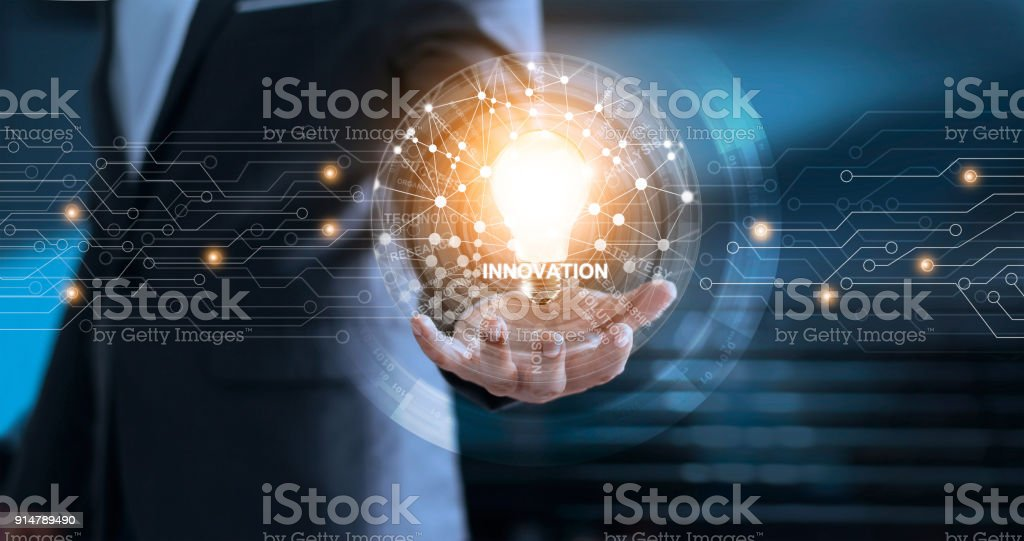 Technology Management Image: Innovation And Technology Concept Businessman Holding