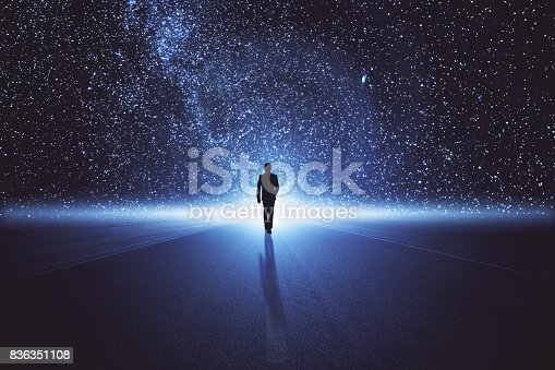 Back view of businessman walking on abstract space road. Innovation concept
