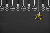 istock Innovation concept with light bulbs on a blackboard background 905396370