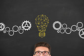 istock Innovation concept with light bulbs on a chalkboard background 917521988