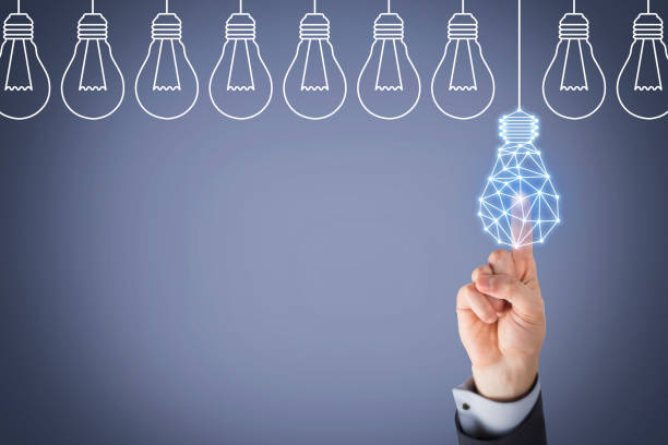Innovation concept with light bulbs on Touch Screen stock photo