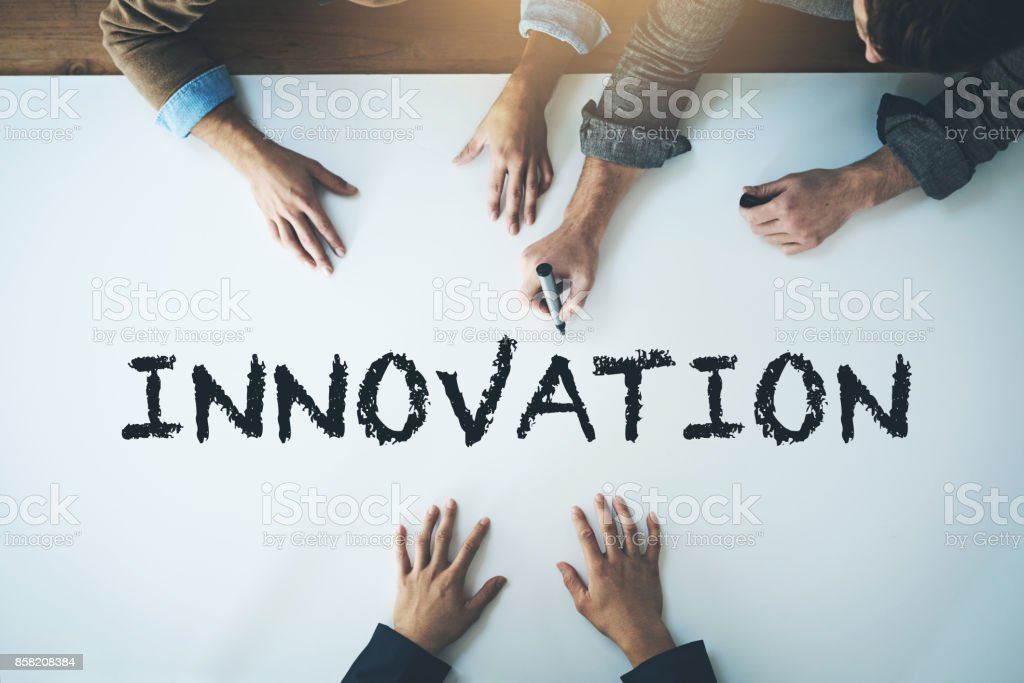 Innovation is change that unlocks new value stock photo