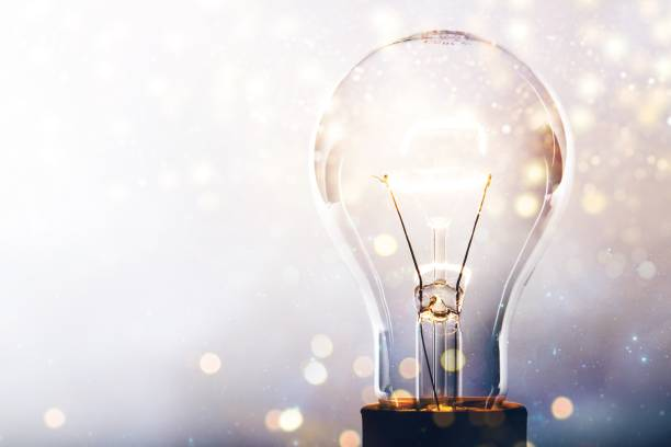 Innovation. Glowing glass light bulb on background light bulb stock pictures, royalty-free photos & images