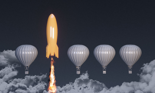 Orange colored rocket rising on the top between the hot air balloons. ( 3d render )