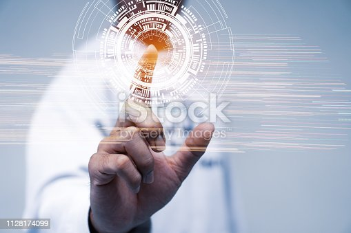 istock Innovation technology business for simulation Futuristic concept. Businessman pressing digital HUD screen button touching presented symbol connected icons over technologies. Idea on Internet of things 1128174099