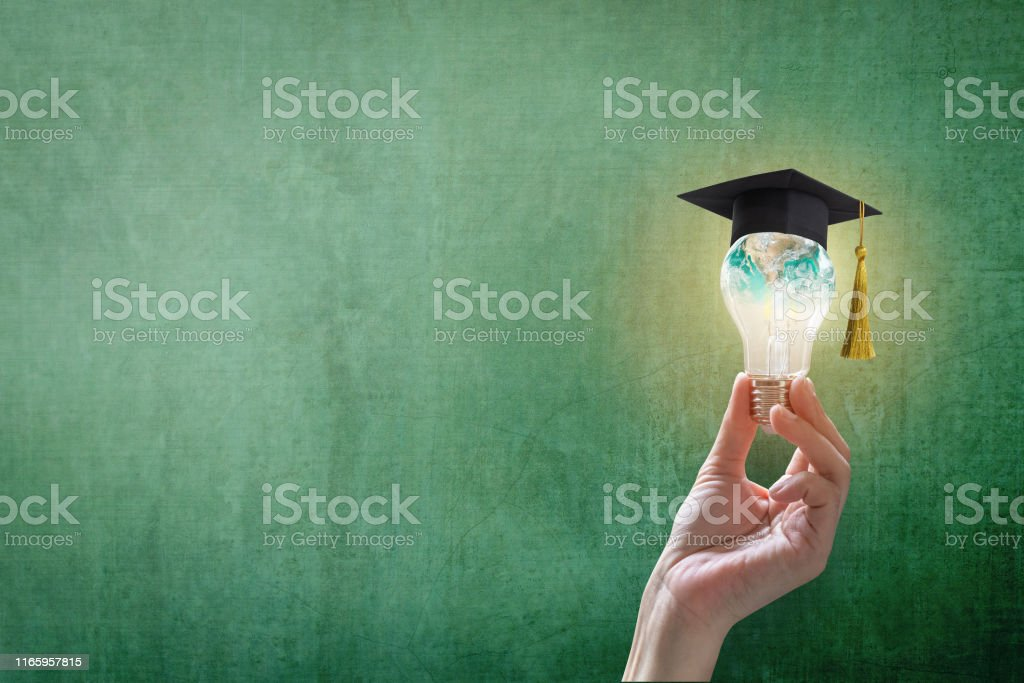 Innovative learning, creative educational study concept for graduation and school student success with world lightbulb on teacher chalkboard - Royalty-free Achievement Stock Photo
