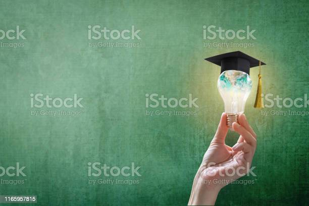Innovative Learning Creative Educational Study Concept For Graduation And School Student Success With World Lightbulb On Teacher Chalkboard Stock Photo - Download Image Now