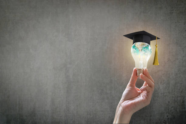 Innovative learning, creative educational study concept for graduation and school student success with world lightbulb on teacher chalkboard stock photo