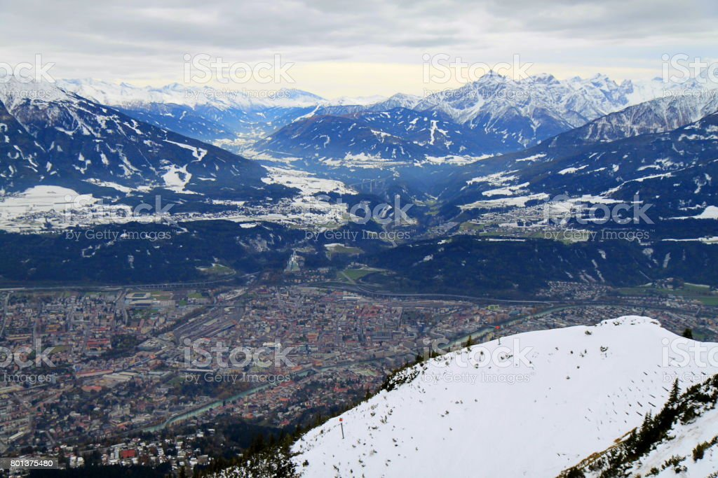 Innsbruck cityscape from Nordkette Snowcapped mountain range panorama of brenner pass and Idyllic Tyrol Karwendel mountain range from above,  Austria stock photo
