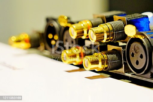 Gold female RCA jack on audio amplifier connector.