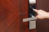 istock inputing passwords on an electronic door lock 611205586