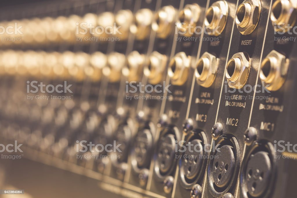 TRS & XLR inputs, outputs on back panel of professional audio equipment stock photo