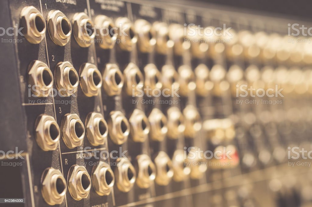 TRS inputs, outputs on back panel of professional audio equipment stock photo