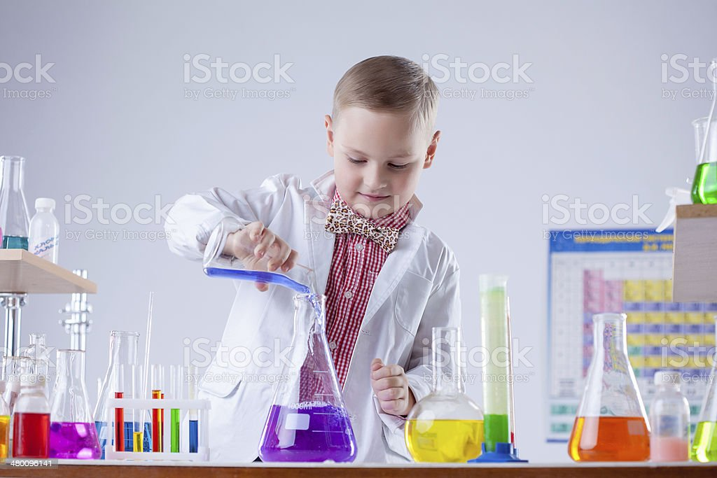 Inquisitive naturalist mixes reagents in flask stock photo
