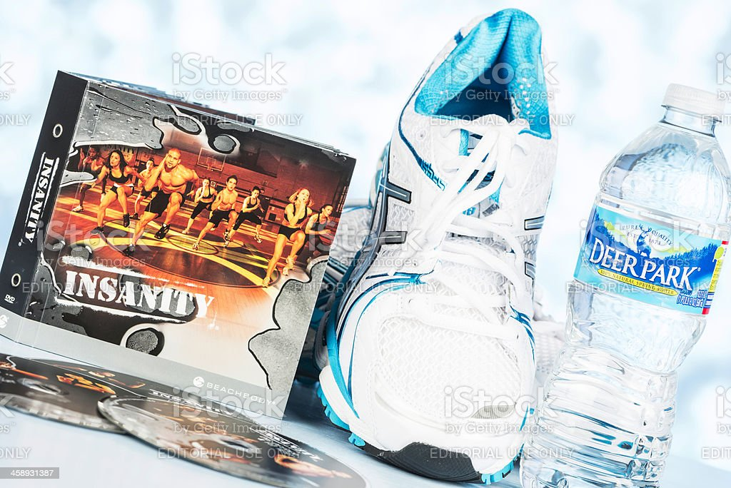 Insanity DVDs and Tennis Shoes royalty-free stock photo