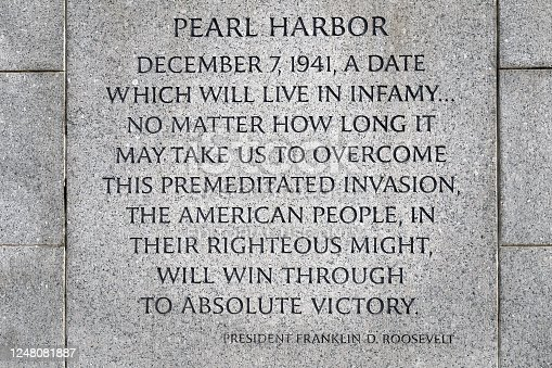Washington, D.C., USA - November 11, 2017: Inscription about Pearl Harbor on the World War II Memorial, located on the National Mall.