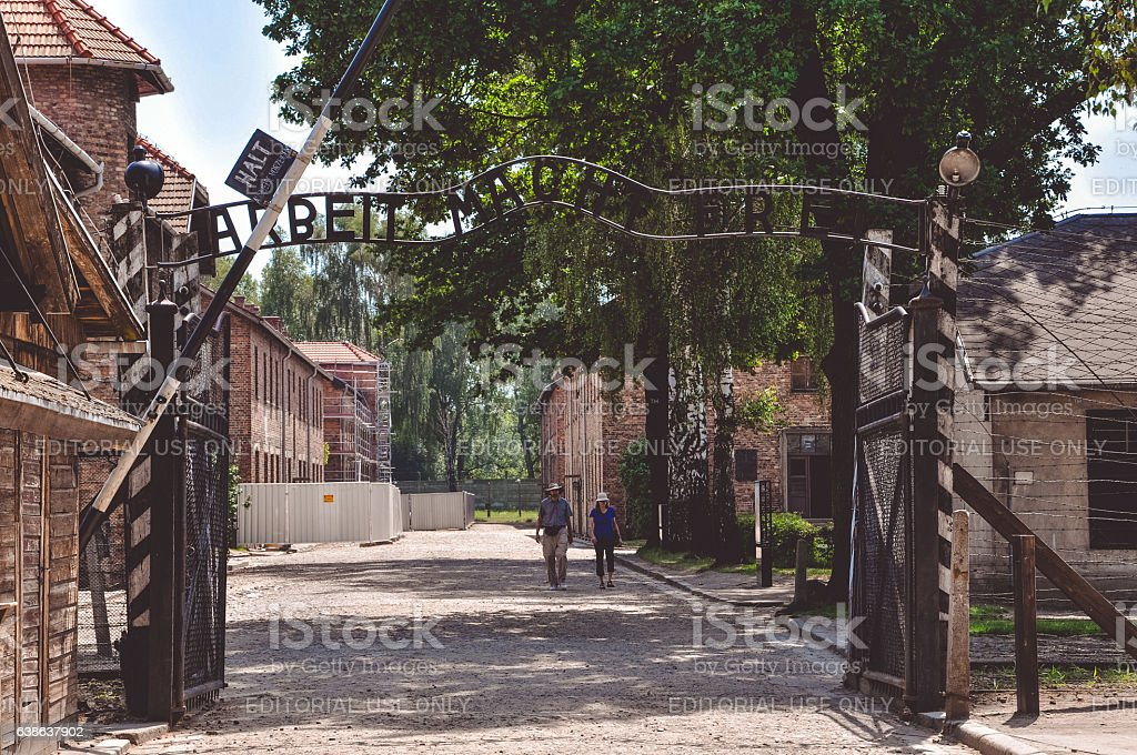 Inscription above the the main gate of the Auschwitz concentration camp – Foto