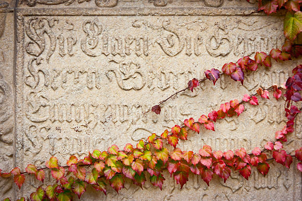Inscription and Ivy Tombstone partially covered by ivy, Bressanone, Trentino Alto Adige, Italy bruneck stock pictures, royalty-free photos & images