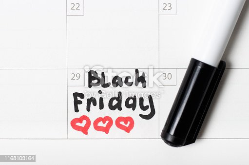 istock Inscription Black Friday on calendar 2019 and heart sign, close-up 1168103164