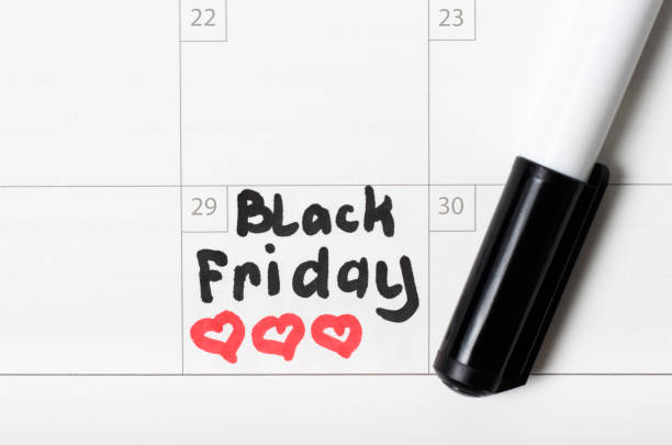 Inscription Black Friday on calendar 2019 and heart sign, close-up stock photo