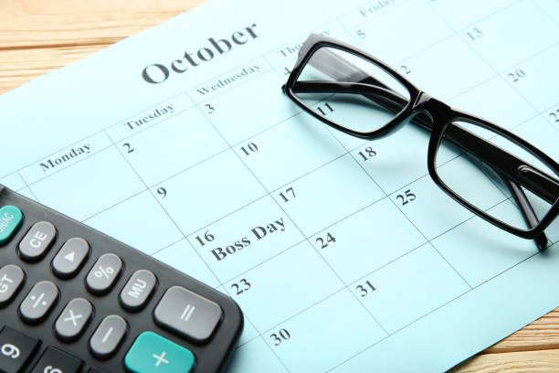 Inscription Boss Day in calendar with calculator and glasses Inscription Boss Day in calendar with calculator and glasses boss's day stock pictures, royalty-free photos & images