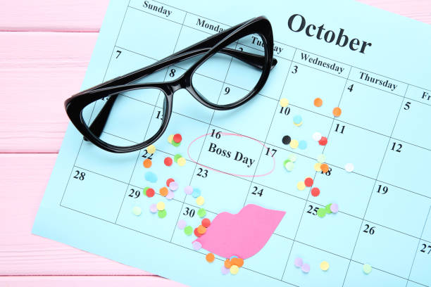 Inscription Boss Day in calendar with glasses and paper lips Inscription Boss Day in calendar with glasses and paper lips boss's day stock pictures, royalty-free photos & images