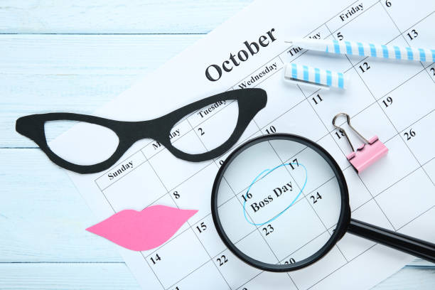 Inscription Boss Day in calendar with magnifying glass and paper glasses Inscription Boss Day in calendar with magnifying glass and paper glasses boss's day stock pictures, royalty-free photos & images