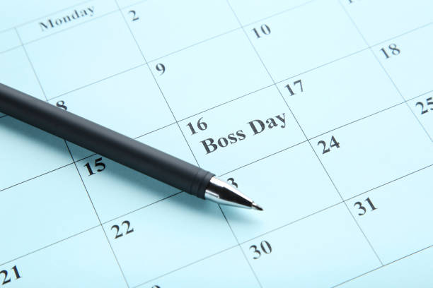 Inscription Boss Day in calendar with pen Inscription Boss Day in calendar with pen boss's day stock pictures, royalty-free photos & images