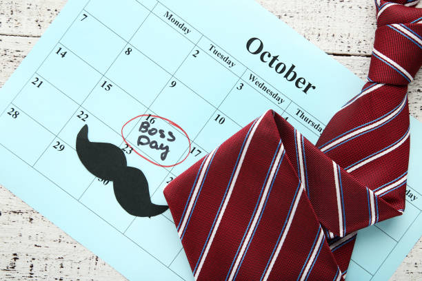 Inscription Boss Day in calendar with tie and paper mustache Inscription Boss Day in calendar with tie and paper mustache boss's day stock pictures, royalty-free photos & images