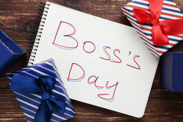 Inscription Boss Day in notebook with gift boxes Inscription Boss Day in notebook with gift boxes boss's day stock pictures, royalty-free photos & images
