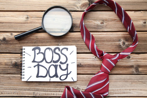 Inscription Boss Day in notebook with magnifying glass and tie Inscription Boss Day in notebook with magnifying glass and tie boss's day stock pictures, royalty-free photos & images