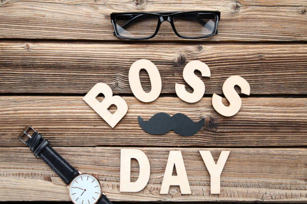 Inscription Boss Day with wrist watch and glasses Inscription Boss Day with wrist watch and glasses boss's day stock pictures, royalty-free photos & images