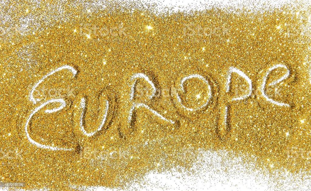 Inscription Europe on golden glitter sparkles on white background