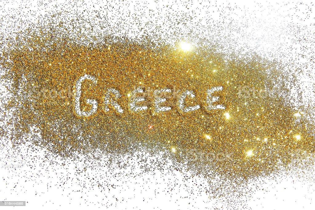 Inscription Greece on golden glitter sparkle on white background