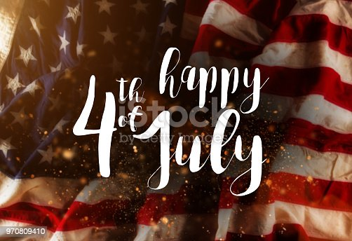 istock Inscription Happy 4th of July with USA flag 970809410