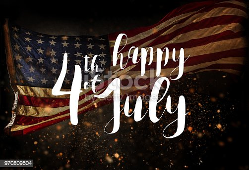 970809318 istock photo Inscription Happy 4th of July with USA flag 970809504