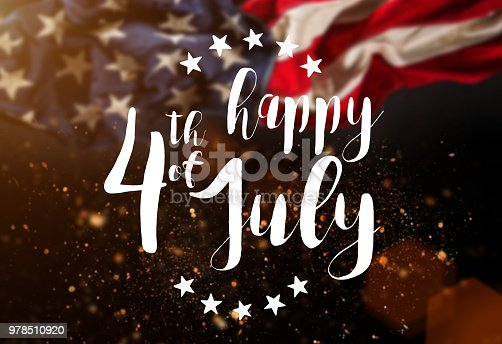970809318 istock photo Inscription Happy 4th of July with USA flag 978510920