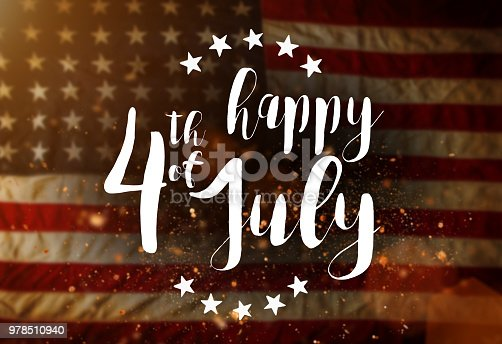 970809318 istock photo Inscription Happy 4th of July with USA flag 978510940