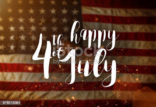 970809318 istock photo Inscription Happy 4th of July with USA flag 978513064