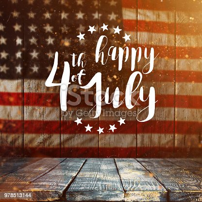 970809318 istock photo Inscription Happy 4th of July with USA flag 978513144