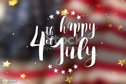 970809318 istock photo Inscription Happy 4th of July with USA flag 978513244
